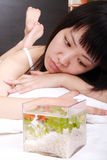 Asian girl with her goldfish Stock Photos