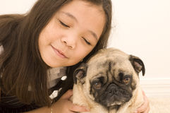 Asian Girl with her Grumpy Dog Royalty Free Stock Images
