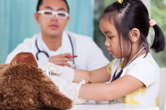 Asian girl and her pediatrician Stock Image