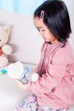 Asian girl and her teddy bear royalty free stock photos