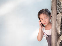 Asian girl hiding behind the wall Stock Image