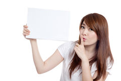 Asian girl hold blank sign and do quite sign Royalty Free Stock Photos