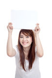 Asian girl hold blank sign over head with both hand Stock Photo