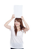 Asian girl hold blank sign over head vertically Royalty Free Stock Photography