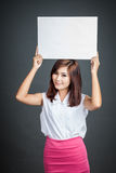 Asian girl hold blank sign over her head Royalty Free Stock Photo