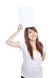 Asian girl hold blank sign over her head Stock Photo