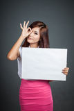 Asian girl hold blank sign show OK sign at her eye Stock Image