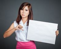 Asian girl hold blank sign and show thumbs down Stock Photography