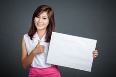 Asian girl hold blank sign and show thumbs up Stock Photography