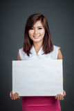 Asian girl hold blank sign and smile Stock Image