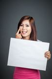 Asian girl hold blank sign sticking out her tongue Stock Photography