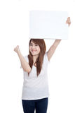 Asian girl hold blank sign with success Stock Photo