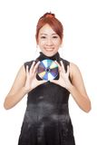 Asian girl hold a disc with her both hands and smile Royalty Free Stock Image