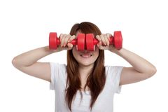 Asian girl hold dumbbells close her eye and smile Stock Images