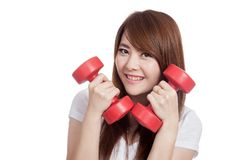 Asian girl hold dumbbells close to her face and smile Royalty Free Stock Photos
