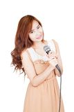 Asian girl hold a microphone Royalty Free Stock Image