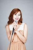 Asian girl hold microphone and smile Royalty Free Stock Image
