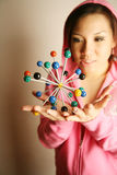 Asian girl holding 3-D diagram Royalty Free Stock Photography