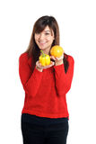 Asian girl holding bell pepper and orange Royalty Free Stock Image
