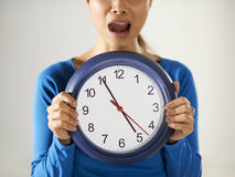 Asian girl holding big blue clock with stress Stock Photo