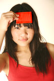 Asian girl holding blank red card Royalty Free Stock Image
