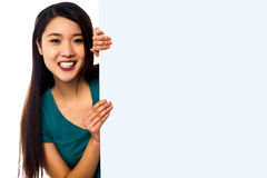 Asian girl holding blank white ad board Stock Photo