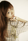 Asian girl holding brass keys royalty free stock photography