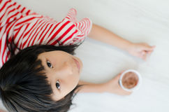 Asian girl holding chocolate icecream cup Stock Images