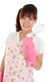 Asian girl holding egg beater Royalty Free Stock Photo