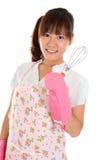 Asian girl holding egg beater. Beautiful Asian girl holding egg beater and smile, isolated on white Royalty Free Stock Photo
