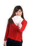 Asian girl holding a few bills of Chinese money Stock Photo