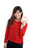 Asian girl holding a few bills of Chinese money Stock Image