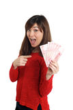 Asian girl holding a few bills of Chinese money Stock Photos