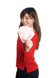 Asian girl holding a few bills of Chinese money Royalty Free Stock Photography