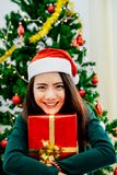 Asian girl holding gift box. On the night of the celebration Christmas party with her family Royalty Free Stock Photo