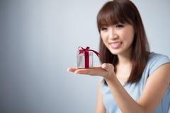 Asian Girl Holding Gift Box Stock Photos