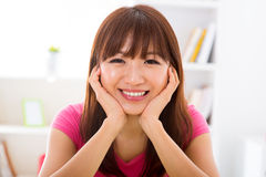 Asian girl holding her face Stock Photo