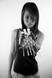 Asian girl holding injection needles Royalty Free Stock Image