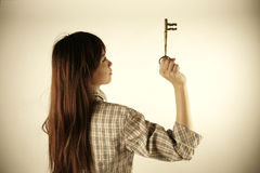 Asian girl holding key Stock Photography