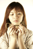 Asian girl holding key Royalty Free Stock Image