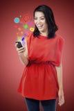 Asian girl holding mobile phone Stock Photos