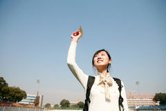 Asian girl holding paper aircraft Royalty Free Stock Photos