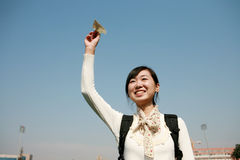 Asian girl holding paper aircraft Stock Image