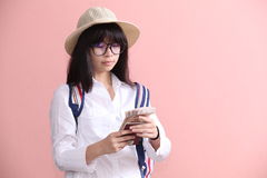 Asian girl holding passport and banknote Stock Photo