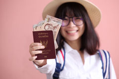 Asian girl holding passport and banknote Stock Photography