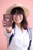 Asian girl holding passport Stock Image