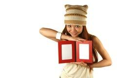 Asian girl holding photo frames Royalty Free Stock Image