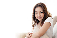 Asian girl holding pillow in Livingroom with happy face Stock Image
