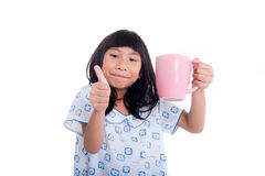 Asian girl holding pink pastel cup and smiling Stock Image