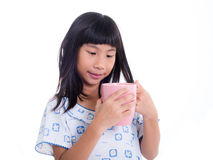 Asian girl holding pink pastel cup and smiling Royalty Free Stock Photo
